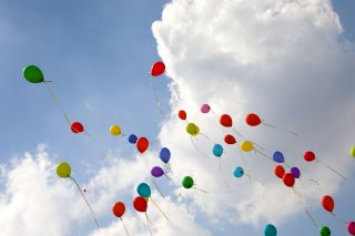 balloons fly high in the sky